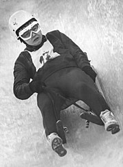 Ortrun Enderlein participating in luge, in the middle of her run