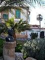 Bust of Haşmet Muzaffer Gürkan and traditional house, Nicosia.jpg
