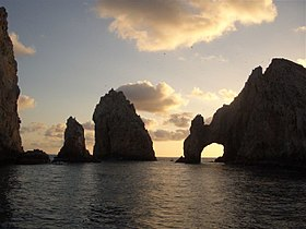 Land's End is at southern tip of Lower California and its arch can be seen in a December sunset