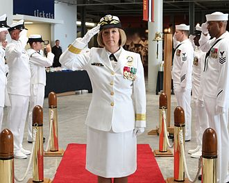 Robin Braun - Braun salutes the sideboys during the Navy Recruiting District New Orleans Change of Command ceremony.