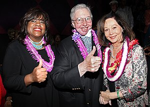 Roger Ebert - Ebert and his wife Chaz Hammelsmith Ebert (left) giving the thumbs up to Nancy Kwan (right) at the Hawaii International Film Festival on October 20, 2010