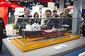 Chief of Naval Operations Adm. Jonathan Greenert, left, looks at a small scale model of the innovative new mobile landing platform ship at the Navy League's Sea-Air-Space Exposition in National Harbor, Md 130408-N-WL435-408.jpg