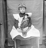 A child and her doll.