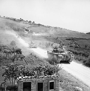 25th Army Tank Brigade - Churchill tanks of 51st Royal Tank Regiment move forward near Isola Del Piano in support of 138th Brigade during the advance on the Gothic Line, Italy.