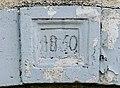Clé de linteau datée de 1850 à Corre.jpg