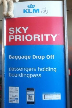 "Dunglish - Dutch compound noun error in English ""boardingpass"" instead of ""boarding pass"", as seen on KLM sign at Schiphol Airport, 2013"