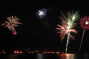 Conesus Lake - Fireworks during the Lake of Fire. The red lights at the bottom are flares.
