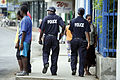 Constables Jack Kanas and Noelline Saksak patrol the streets of Port Vila, Vanuatu 2007. Photo- Rob Maccoll - AusAID (10690055865).jpg