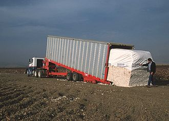Cotton production in the United States - Loading cotton module in California (2002)