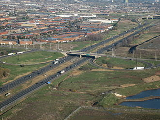 Ontario Highway 410 - The 410 interchange with Courtneypark Drive, prior to the reconfiguration of the ramp exiting the freeway, also showing the freeway's grass median prior to expansion