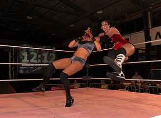Rosemary (wrestler) - Rush (right) clotheslining Cheerleader Melissa at nCw Femmes Fatales XIV