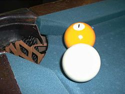 A cue ball and the 1 ball close to a pocket