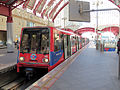DLR Train in Canary Wharf station (8720495495).jpg