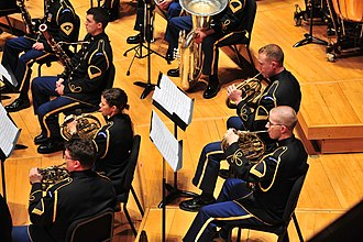French horn - A horn section in a military concert band