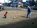 Danny Fitzpatrick playing soccer with and APEX youth.jpg