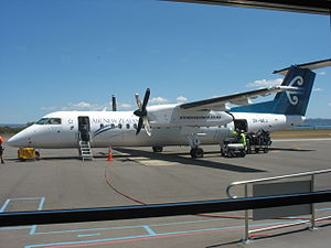 Rotorua Regional Airport - A Bombardier Q300 operated by Air New Zealand's subsidiary Air Nelson parked on the apron.
