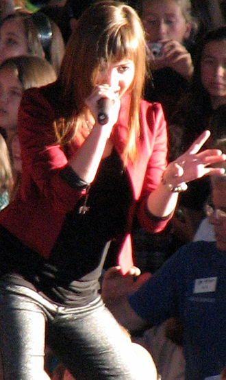 Demi Lovato - Lovato performing during the Demi Live! Warm Up Tour in July 2008.