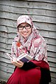 Dewi Nur Aisyah Reading Book.jpg
