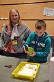 """Die!!! Weihnachtsfeier 2013, 070 die ehrenamtlichen Helfer Stephanie Ristig-Bresser und ein Junge beim Befeuchten von Papier zum """"Geld"""" drucken mit Wolfgang Jeske.jpg"""