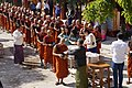 Donation monks. Mandalay Patheingyi Yankin Hill.jpg