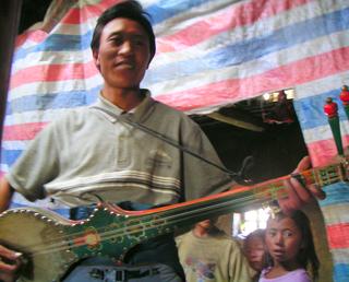 Dramyin traditional Himalayan folk music lute with six strings