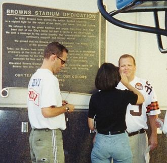 Drew Carey - Carey preparing for a TV broadcast at the dedication of Cleveland Browns Stadium, September 1999