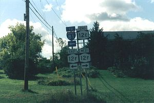 New York State Route 12E - The signed southern terminus of NY 12E at the junction of NY 12F and Bridge Street in Brownville