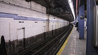 Proposed expansion of the New York City Subway - At East Broadway on the IND Sixth Avenue Line (shown), part of a two-track station was built for the IND Worth Street Line under East Broadway, above the existing line. The indent for the never-built line is seen at the top of the picture, crossing the ceiling.