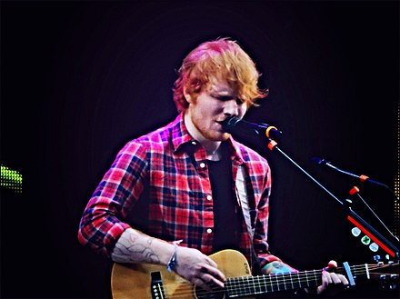 Ed Sheeran was awarded the IFPI Global Recording Artist of 2017 and is the first winner to have both the year's best-selling single and album. Ed Sheeran, V Festival 2014, Chelmsford (14788797777).jpg