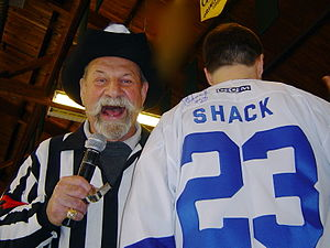 Eddie Shack - Eddie Shack (in referee uniform) hams it up at an NHL oldtimers charity event.