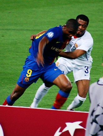 Samuel Eto'o - Eto'o of Barcelona challenged by Patrice Evra of Manchester United in the 2009 UEFA Champions League Final