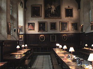 High Table - View towards the High Table in the dining hall of Exeter College, Oxford.