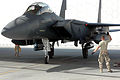 F-15E Strike Eagle guided into position by a crew chief.jpg