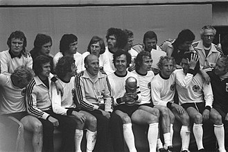 Jupp Heynckes - Heynckes (Bottom second left) with his teammates after winning the 1974 FIFA World Cup on 7 July