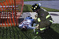 Firefighter SSgt Jeffrey Yelencich aids a simulated casualty portrayed by Civil Air Patrol Michigan Wing cadet.jpg