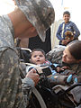 Flickr - The U.S. Army - Mahmudiyah children receive wheelchairs from 'Iron Brigade'.jpg