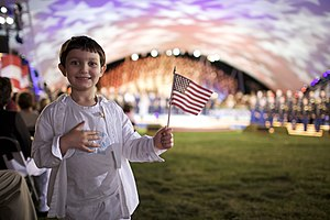 Flag of the United States - A boy holds an American flag during the 2009 National Memorial Day Concert in Washington, D.C.