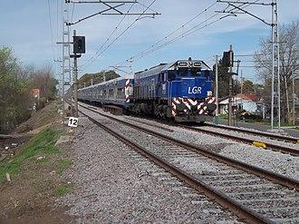 Roca Line - A train powered by an EMD GT22 Series locomotive near Claypole.