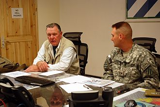 Jack Keane - Keane (left) meeting with an army colonel