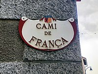 A street sign with the words CAMI DE FRANÇA.