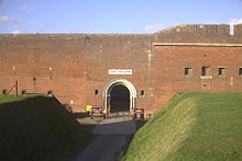 A front facing view of Fort Nelson, one of the old Palmerston Forts which circle the town. The fort itself is made up of a large, plain brick wall.