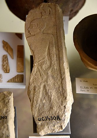 El Kab - Fragment of a relief block or stela. Standing male figure below hieroglyphs. Limestone. 4th Dynasty. From the mastaba of Kameni (Ka-Mena) at El Kab (Nekheb), Egypt. The Petrie Museum of Egyptian Archaeology, London