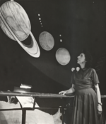 Frances Wright examining a planetary exhibit.png