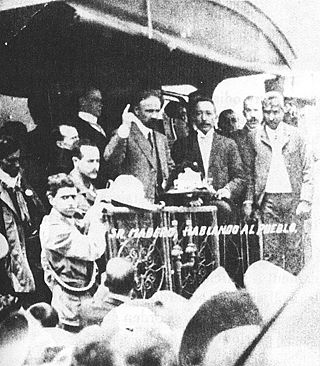 Francisco I. Madero campaigns from the back of a railway car in 1910. Francisco I Madero campaigning.jpg