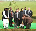 Francois Hollande planting a sapling, at Rajghat, in Delhi on January 25, 2016. The Minister of State for Environment, Forest and Climate Change (Independent Charge), Shri Prakash Javadekar is also seen.jpg