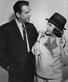 Black and white photo of a man and woman looking at each other
