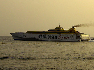 Fred. Olsen Express - Benchijigua Express heading into a sunset en route to La Gomera