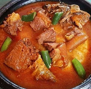 Fufu and light soup with meat.jpg