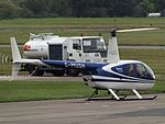 G-MUSH Robinson Raven 44 Helicopter Flightpath Ltd C-O East Midlands Helicopters (29123378024).jpg
