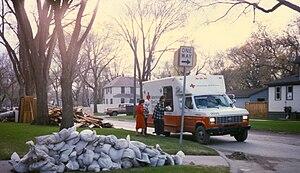 An American Red Cross vehicle distributing foo...
